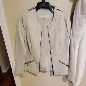 White cream faux leather jacket.